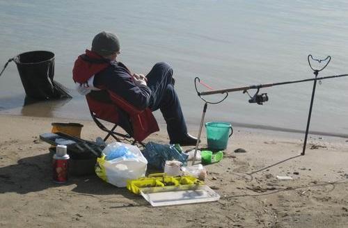 рыбак со снастями